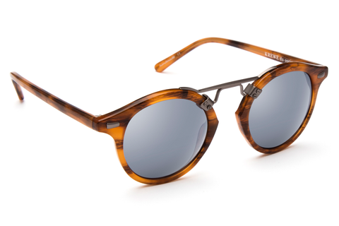 St. Louis Cypress boasts a brushed metal bridge, rounded silver mirrored lenses and a retro-inspired silhouette making it a celebrity favorite.  Gigi Hadid, Kendall Jenner, Adriana Lima, Selena Gomez, Dakota Fanning, Michiel Huisman, Beyonce, Kate Hudson, Julianne Hough, and Olivia Culpo all own a pair. These best-selling sunglasses are crafted from acetate and derive inspiration from the French Quarter's iconic cast-iron balconies. Free shipping both ways.