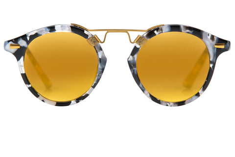 St. Louis Interstellar boasts a 24K bridge, rounded gold mirrored lenses and a retro-inspired silhouette making it a celebrity favorite.  Gigi, Kendall, Adriana Lima, Selena Gomez and Dakota Fanning all own a pair. These best-selling sunglasses are crafted from acetate and derive inspiration from the French Quarter's iconic cast-iron balconies. Free shipping both ways.