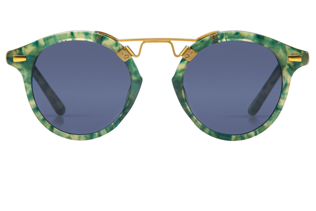 St. Louis Ivy boasts a 24K bridge, rounded blue polarized lenses and a retro-inspired silhouette making it a celebrity favorite.  Gigi, Kendall, Adriana Lima, Selena Gomez and Dakota Fanning all own a pair. These best-selling sunglasses are crafted from acetate and derive inspiration from the French Quarter's iconic cast-iron balconies. Free shipping both ways.