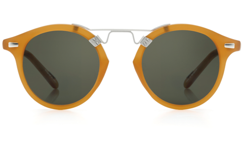 St. Louis Matte Blonde boasts a brushed metal bridge, rounded green lenses and a retro-inspired silhouette making it a celebrity favorite.  Gigi, Kendall, Adriana Lima, Selena Gomez and Dakota Fanning all own a pair. These best-selling sunglasses are crafted from acetate and derive inspiration from the French Quarter's iconic cast-iron balconies. Free shipping both ways.