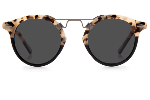 St. Louis Oyster to Black Polarized boasts a 24K bridge, rounded grey polarized lenses and a retro-inspired silhouette making it a celebrity favorite.  Gigi Hadid, Kendall Jenner, Adriana Lima, Selena Gomez, Dakota Fanning, and Michiel Huisman all own a pair. These best-selling sunglasses are crafted from acetate and derive inspiration from the French Quarter's iconic cast-iron balconies. Free shipping and lifetime warranty.