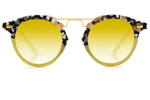 St. Louis Matte Plume to Palm boasts a 24K bridge, rounded amber gradient gold mirrored lenses and a retro-inspired silhouette making it a celebrity favorite.  Gigi Hadid, Kendall Jenner, Adriana Lima, Selena Gomez, Dakota Fanning, and Michiel Huisman all own a pair. These best-selling sunglasses are crafted from acetate and derive inspiration from the French Quarter's iconic cast-iron balconies. Free shipping and lifetime warranty.