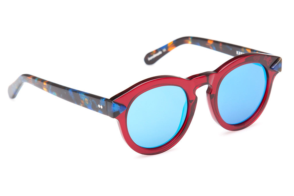 Expressing the eccentric style of the French Quarter, Toulouse's flat lenses, two-tone construction, and rounded, vintage-inspired shape evokes a soulful, offbeat vibe.  Featuring a blue mirrored flat lens with hand crafted burgundy and blue steel acetate.