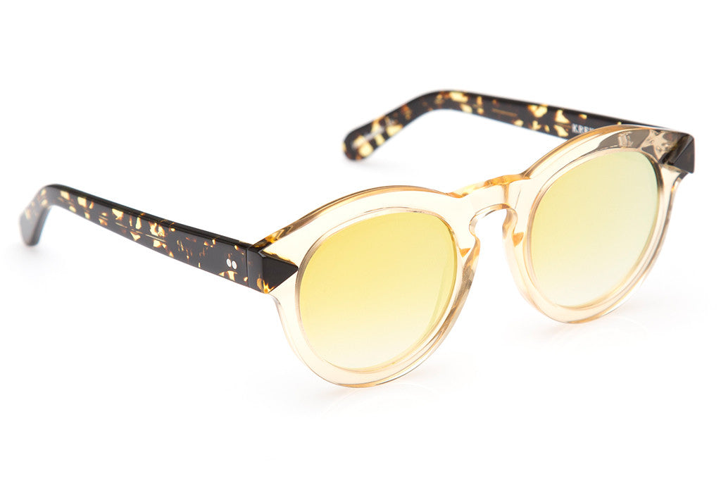 Expressing the eccentric style of the French Quarter, Toulouse's flat lenses, two-tone construction, and rounded, vintage-inspired shape evokes a soulful, offbeat vibe.  Free shipping and lifetime warranty.  Gold gradient mirrored flat lens and handcrafted champagne acetate frame.