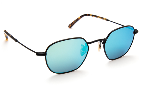 Ultra-lightweight titanium construction, with a nod to the music scene coming out of New Orleans' many wards, gives this frame a sleek, distinctive edge. As seen on Gigi Hadid, Kendall Jenner, Zayn Malik, and Sofia Richie.  Free shipping and lifetime warranty.  Seafoam mirrored lens and handcrafted rex acetate frame with 24K gold plated titanium hardware.