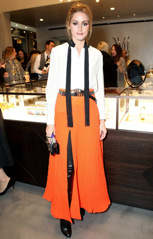 Olivia Palermo stands out in zesty orange thigh-split skirt
