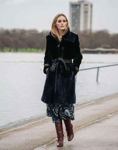 Olivia Palermo in a belted trench coat