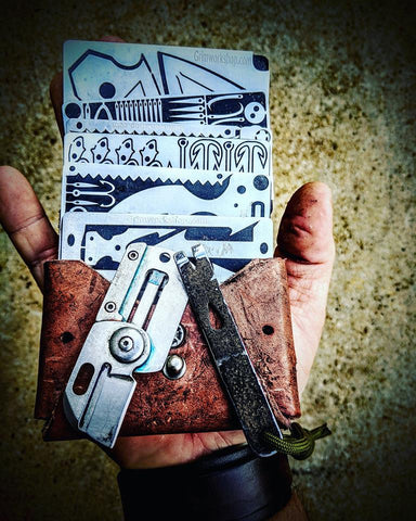 Image of Folding Knife Dog Tag Survival Necklace-Grimworkshop-bugoutbag-bushcraft-edc-gear-edctool-everydaycarry-survivalcard-survivalkit-wilderness-prepping-toolkit