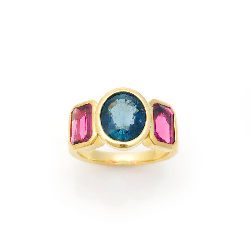 Stunning Blue Tourmaline Oval with twin Hot Pink Tourmalines in 9 carat Yellow Gold