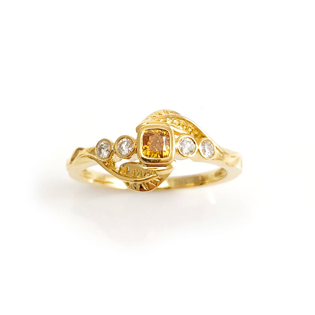 Golden Yellow Diamond Leaf ring with White Diamonds in 18 carat Yellow Gold