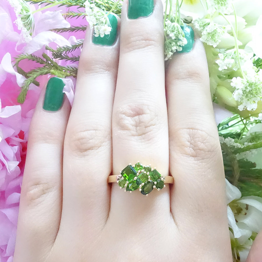 Green Cluster ring in 9 carat Yellow Gold