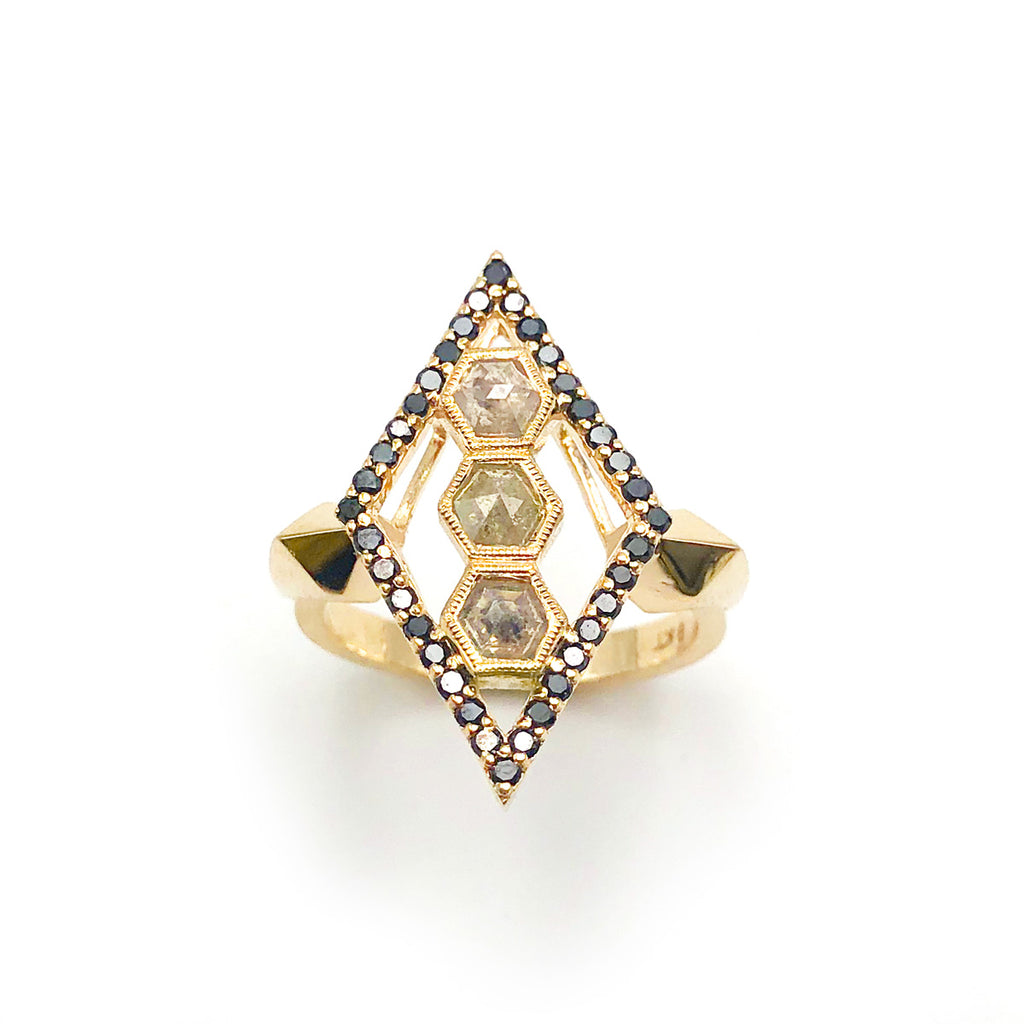 Interdimensional Ring with a triple set of hexagon cut Character Diamonds, surrounded in Black Diamonds and set in 9 carat Yellow Gold
