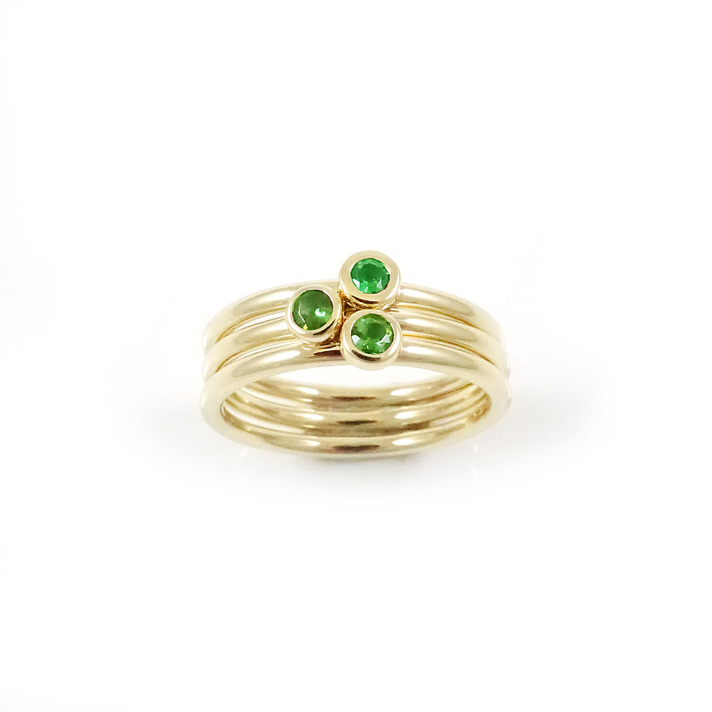 Three Muses ring with Green Tourmalines set in 9 carat Yellow Gold