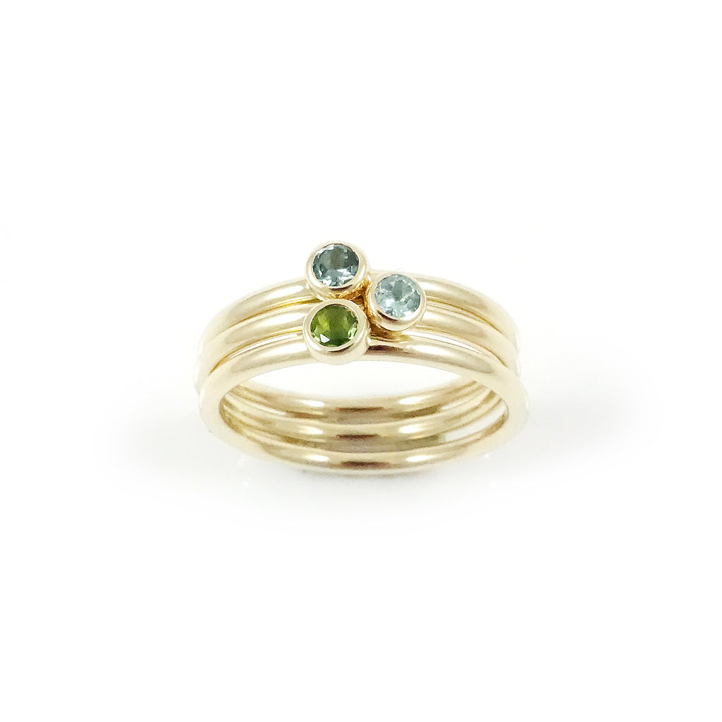 Three Muses ring with Blue and Green Tourmalines set in 9 carat Yellow Gold