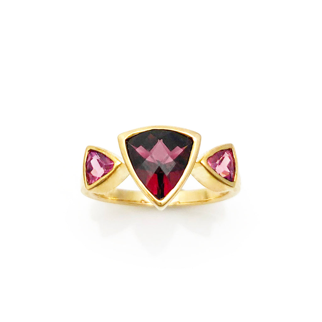 Triple Trillion Dark Pink Spinel ring in 9 carat Yellow Gold