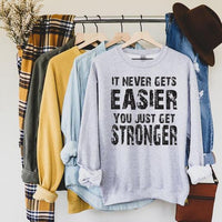 Youth & Adult It Never Gets Easier You Just Get Stronger Graphic Sweatshirt