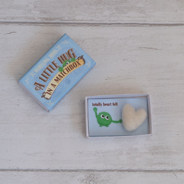 a needle felt heart in a little hug alternative card in a matchbox with hug instruction cards