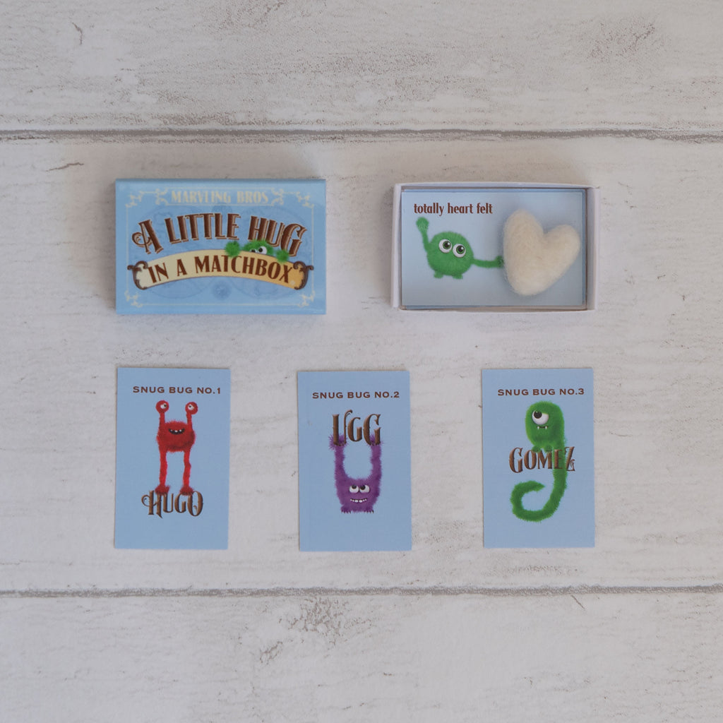 a needle felt heart in a little  hug gift matchbox with hug card instructions