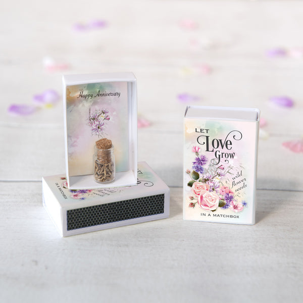 Happy Anniversary Message And Flower Seeds In A Matchbox