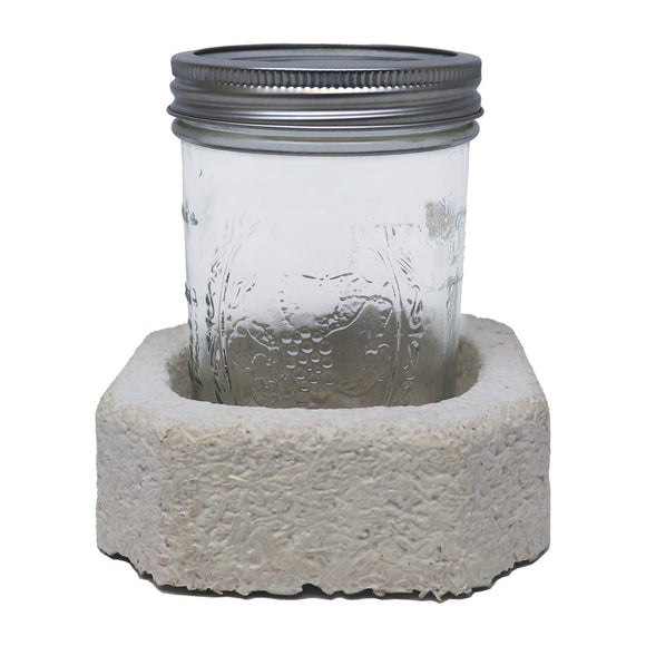 Preparing to mail a mason jar with mushroom packaging