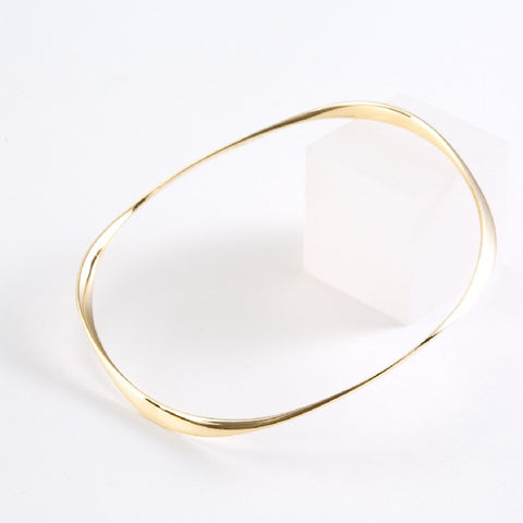 14k yellow gold High Polish Wave Bangle