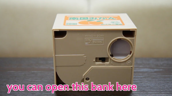 change the batteries and remove coins from the bottom of the coin bank