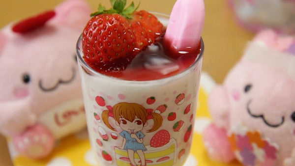 top your parfait with a strawberry of your favorite fruit