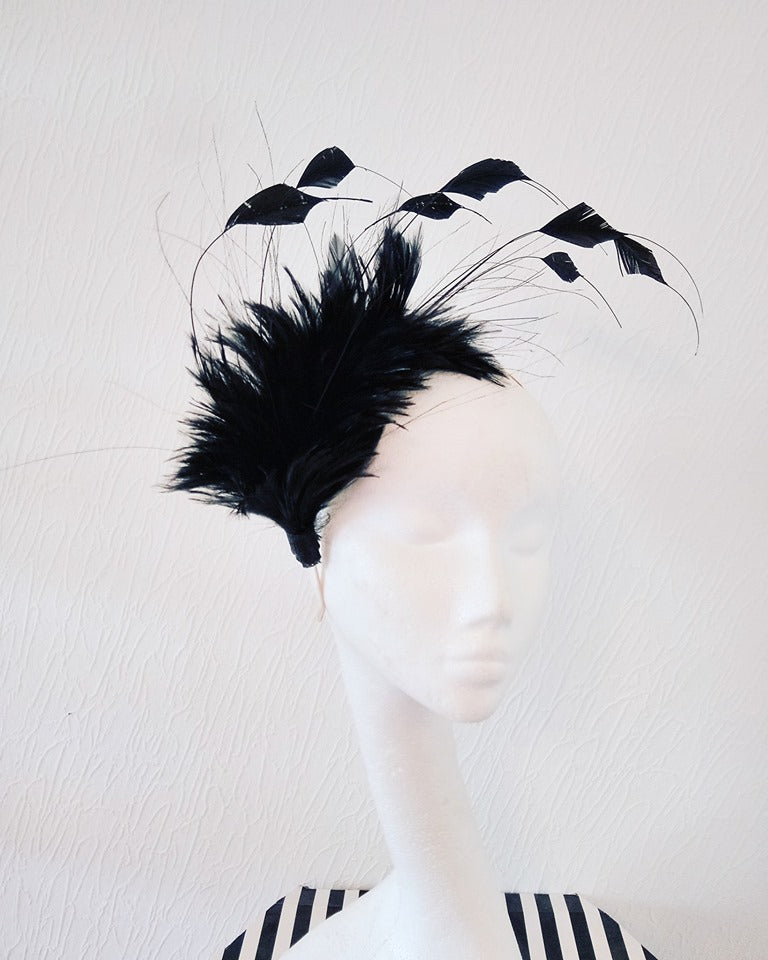 Black feathered fascinator