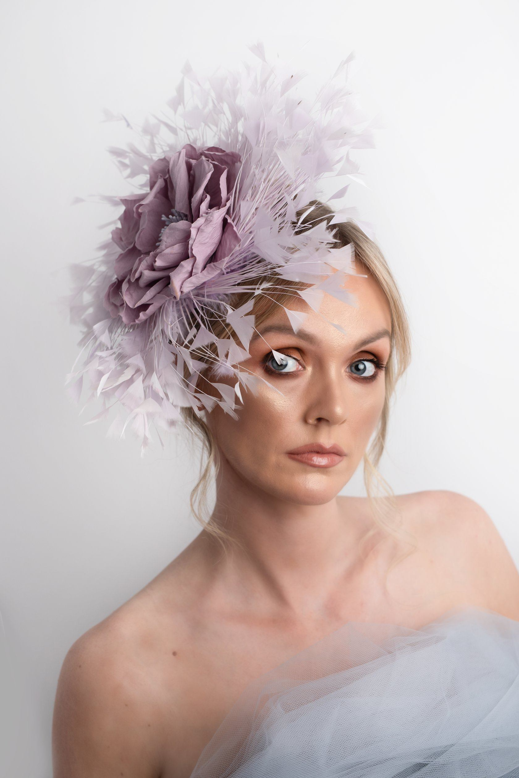 Lilac Silk Flower Feathered Fascinator