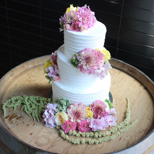 3 Tier Buttercream with Scatted flowers