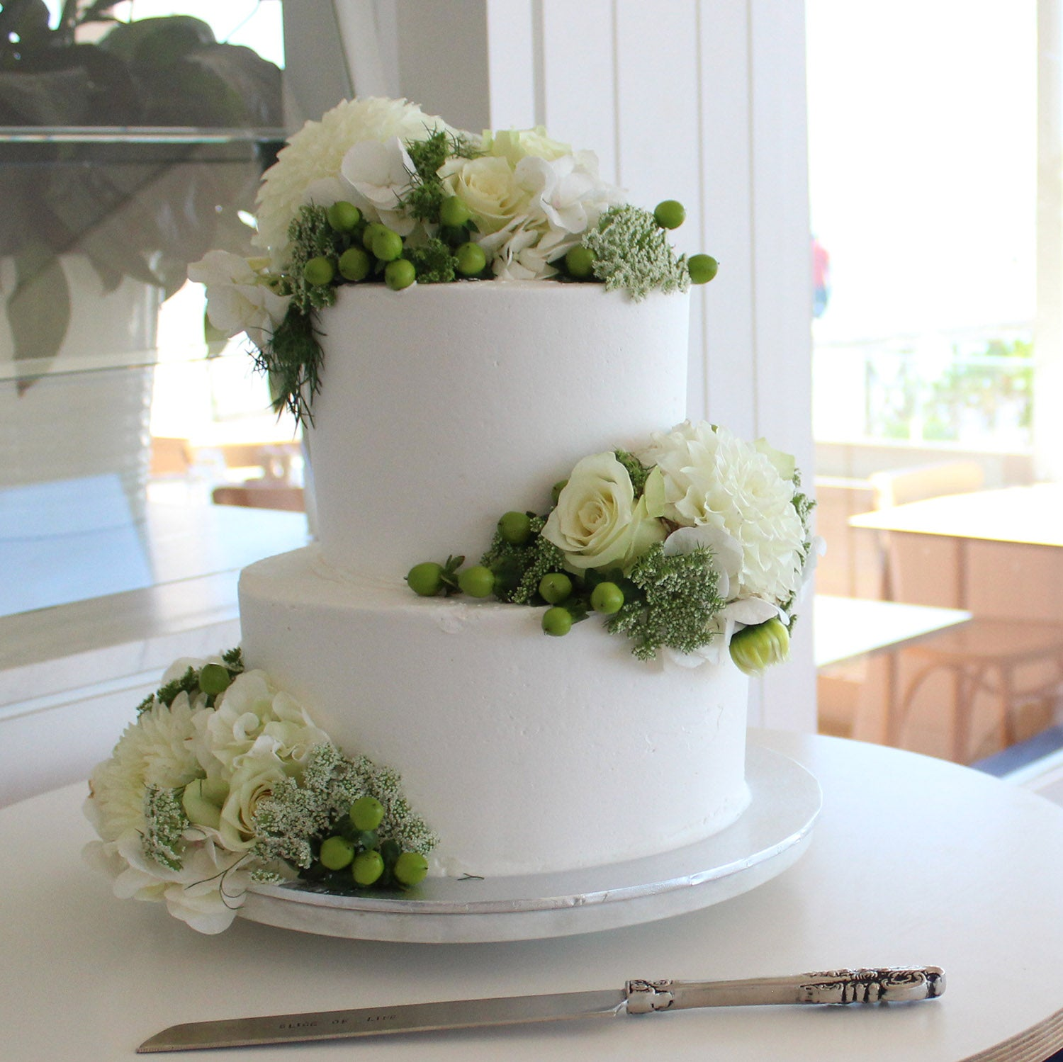 2 Tier Buttercream with Scatted flowers