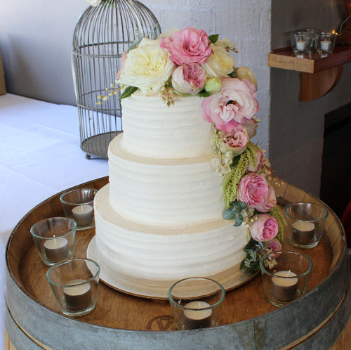 3 Tier Buttercream with Cascading flowers