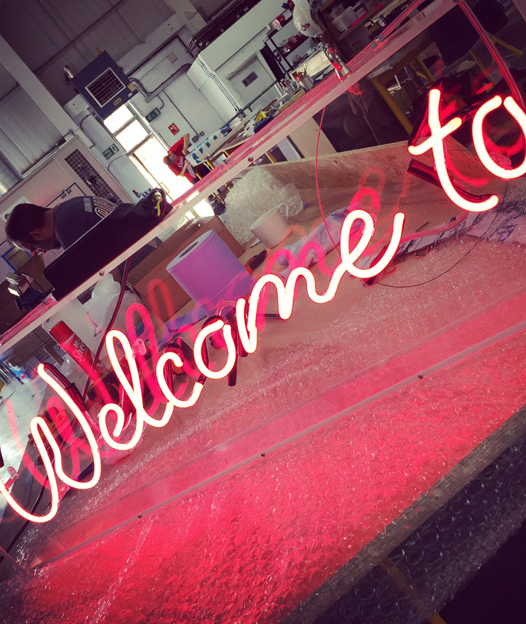 Neon Script Sign on clear acrylic