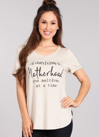 'Surviving Motherhood one meltdown at a time' Graphic Tee in Oatmeal