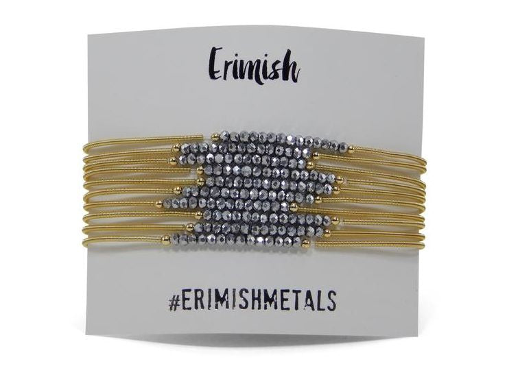 "Erimish Gold ""Slinky"" Set in Silver"