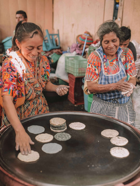 Women making tortillas in Chichi, Guatemala