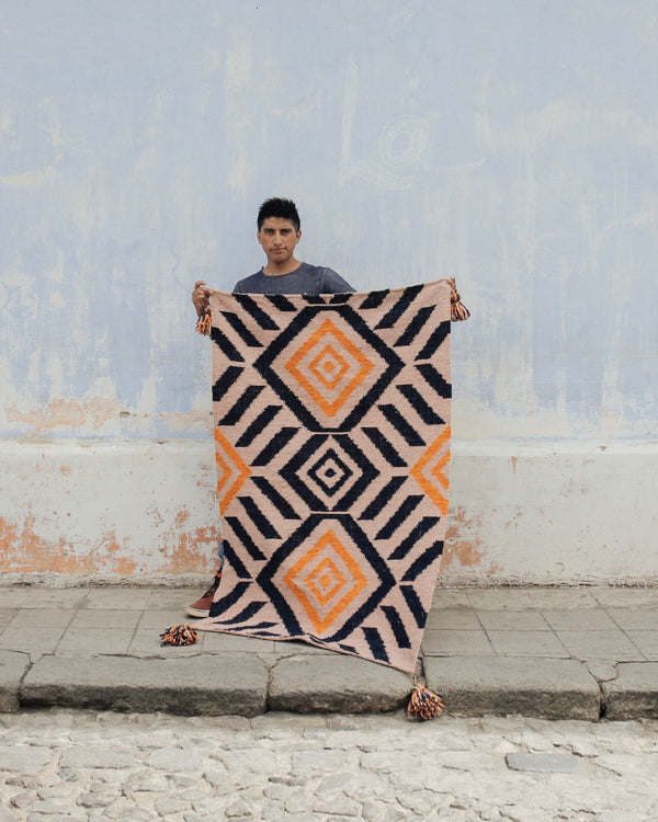 Artisan holding Story of Source Falseria Runner Rug