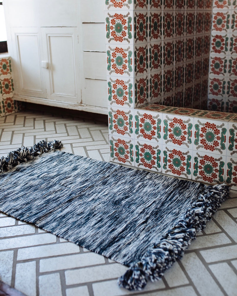 Story of Source Jaspe Basura Rug styled by the shower