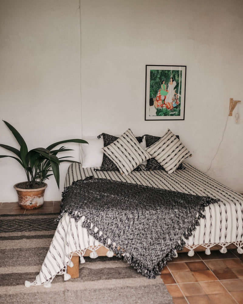 Bed styled with Story of Source Jaspe Bed Set, Jaspe Basura throw & Striped pepenaod rug