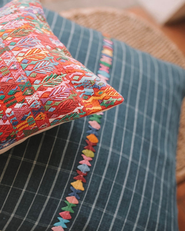 Closeup of Story of Source San Pedro Oversized Square Cushion and Red Tactic Cushion