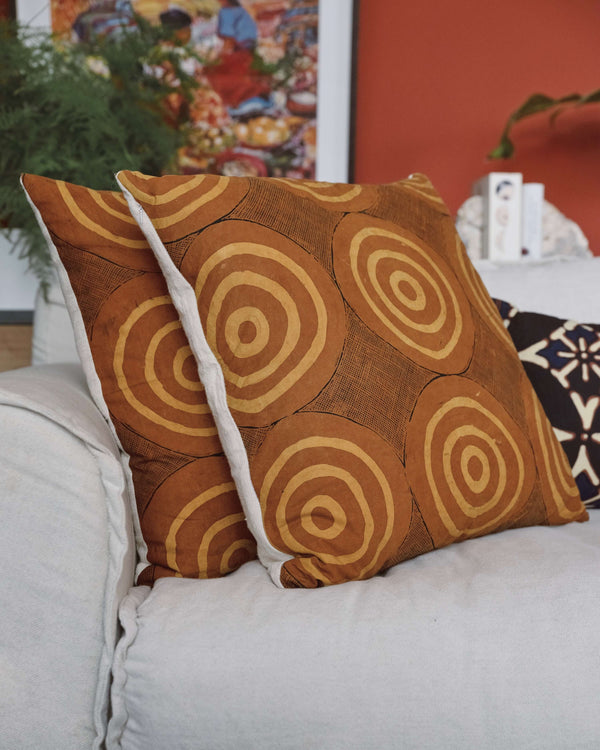 Story of Source Spiral Lou Zeldis batik cushion closeup