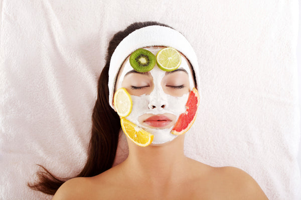 Woman wearing a natural, fruit-based facial mask