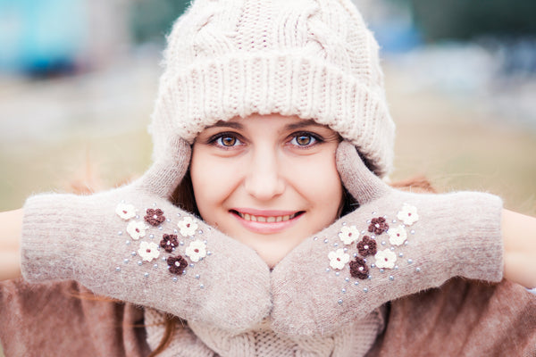 Woman with beautiful skin showing her face in winter
