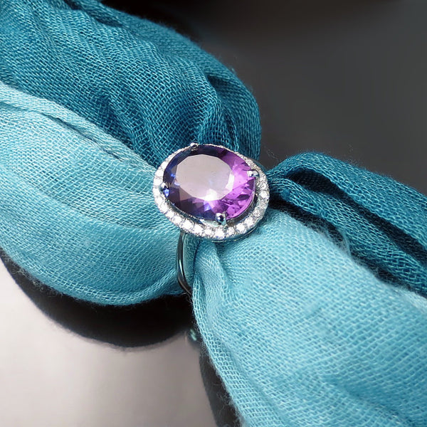 Oval Amethyst and Diamond Halo Ring