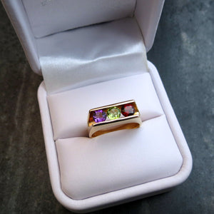 modern ring with amethyst peridot garnet gemstones