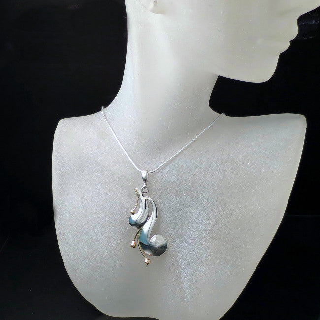 Unique handmade jewelry in silver and gold.