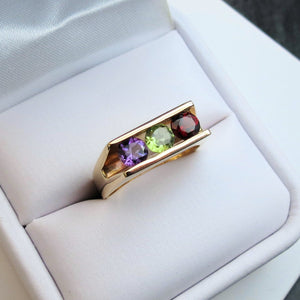 gold gemstone ring channel setting
