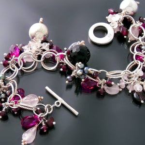 Silver bracelet with black and pink gemstones
