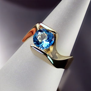 Unique yellow gold blue topaz ring
