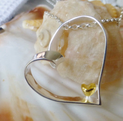 'I Carry Your Heart' Silver and gold Pendant and Chain